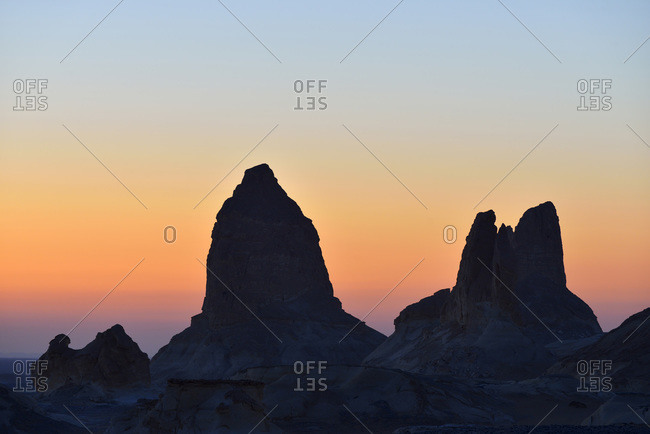 Silhouette of rock formations at dawn in White Desert, Sahara Desert