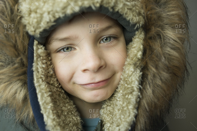 Portrait of a child wearing a furry hooded parka