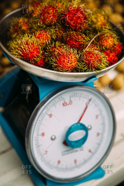 Rambutan fruits on a scale