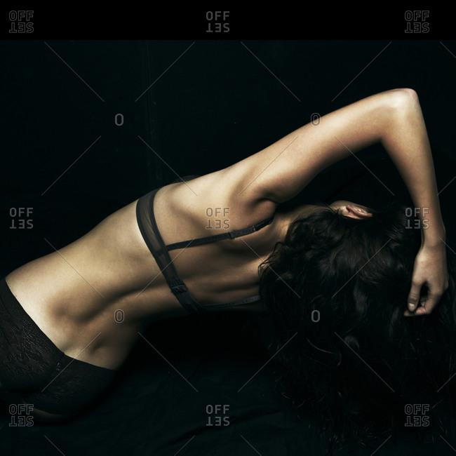 Woman leaning sideways in lingerie