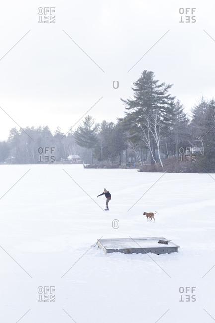 A woman ice skates on a frozen lake