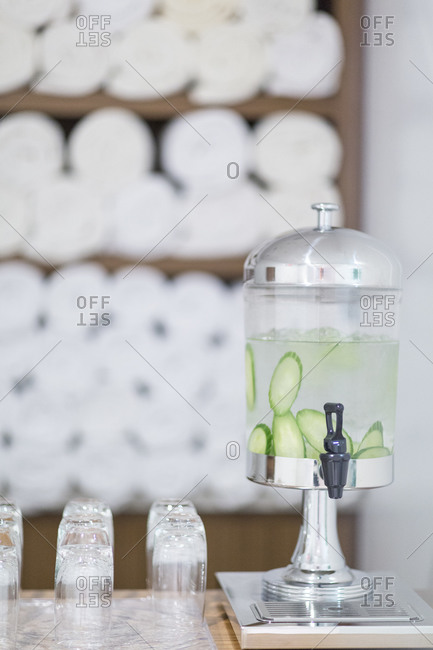 A water dispenser with cucumber water