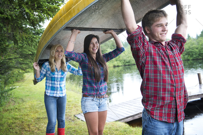 Teenagers carrying a canoe - Offset