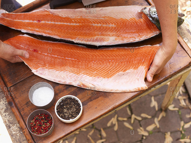 Person preparing fish fillets