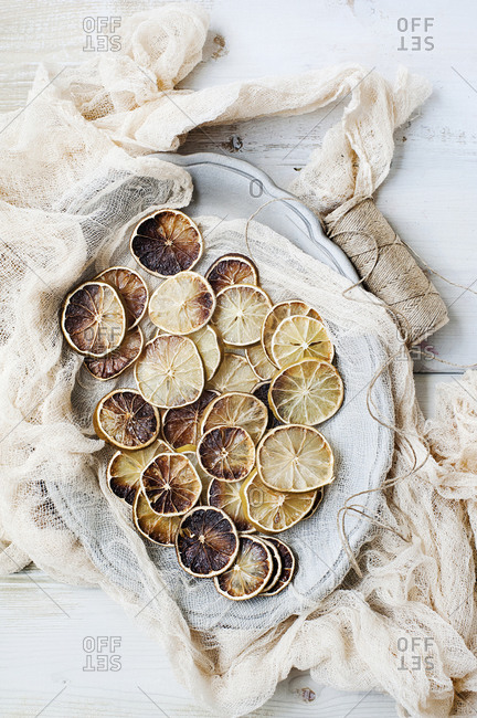 Dried lemon slices on plate with cheesecloth