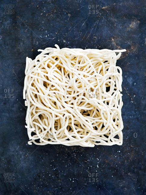 A square of raw ramen noodles