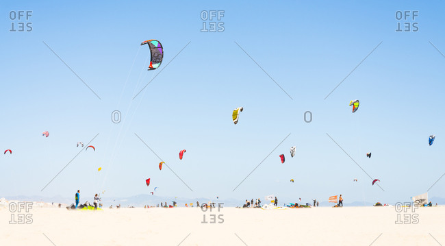 Gathering of kite surfers on a beach