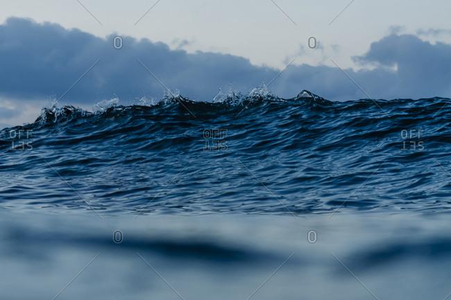 The peak of a dark ocean wave