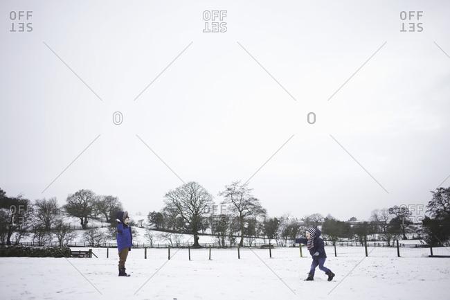 Boys having a snowball fight