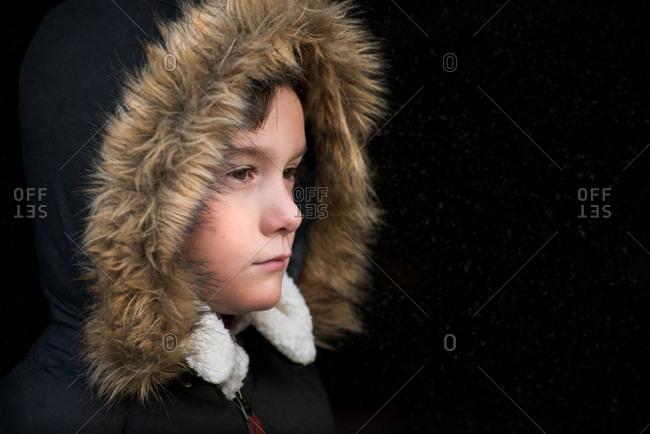 Portrait of a boy in furry hood