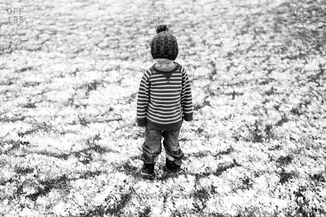 A boy stands in snow