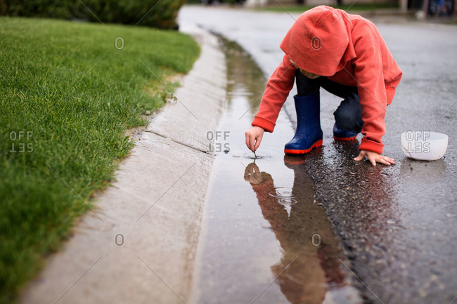Boy hunting for earthworms