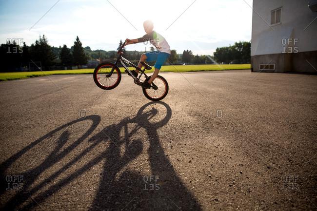 Boy riding his BMX bike