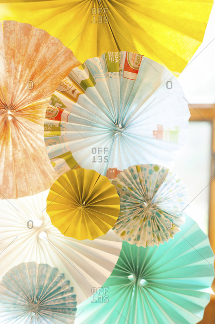 Details of DIY paper pinwheel wedding arch