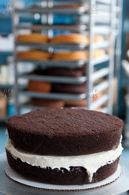 Chocolate cake with vanilla frosting in a bakery
