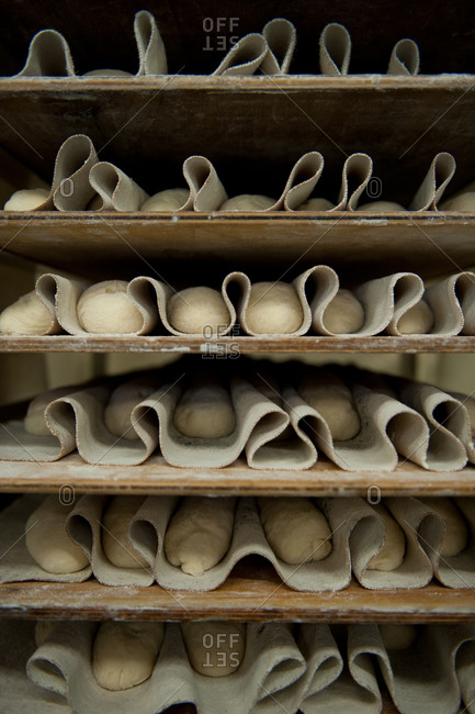 Shelves of unbaked baguettes