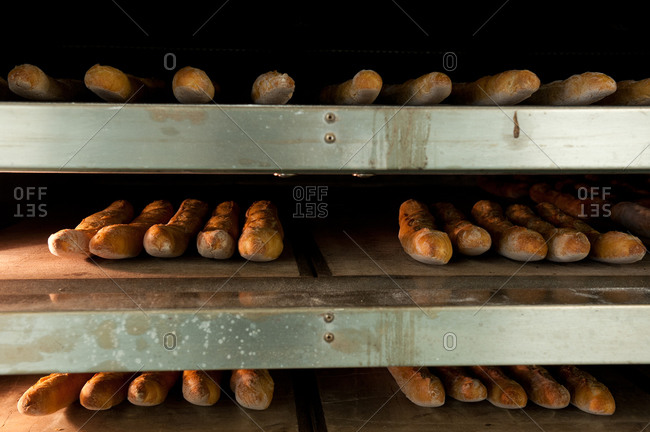 Baguettes in the oven at a bakery
