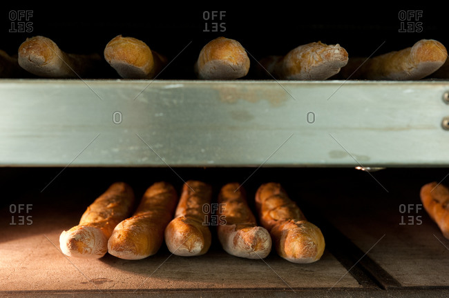 Baguettes baking in an oven