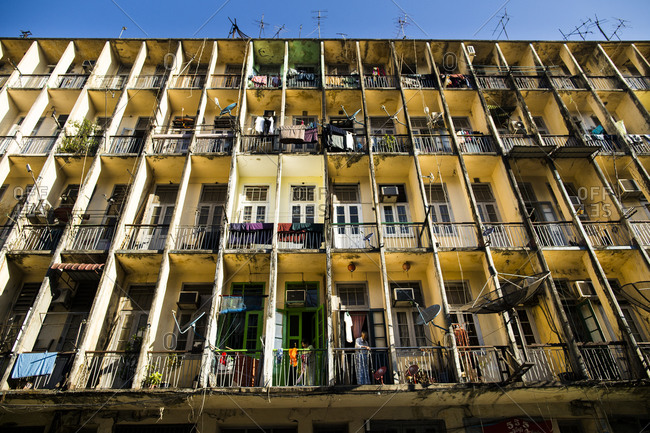 Yangon, Myanmar - January 29, 2015: A dilapidated building in downtown