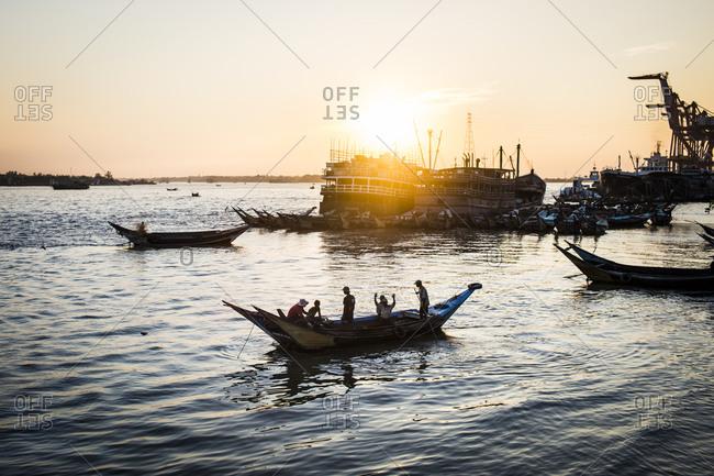 Yangon, Myanmar - January 31, 2015: Sunset along the Yangon River in Yangon, Myanmar
