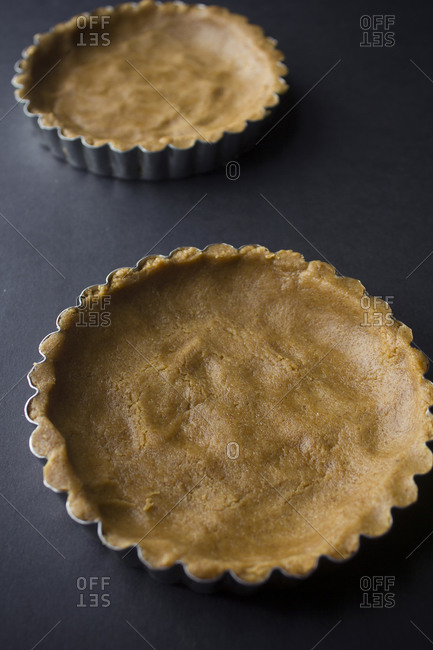 Tart tins with dough pressed into them
