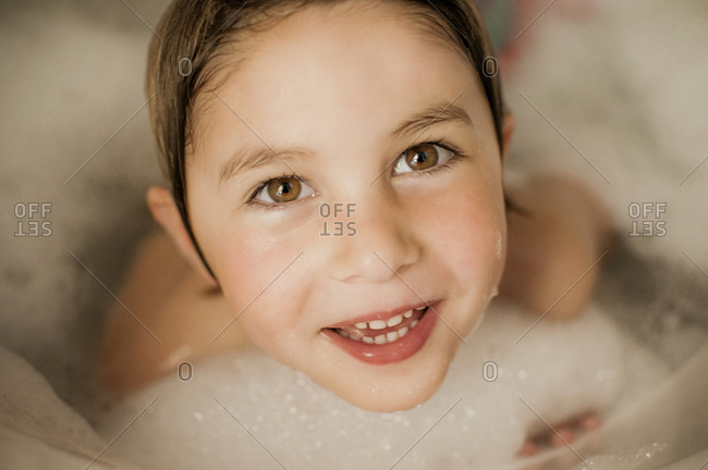 A little girl taking a bubble bath