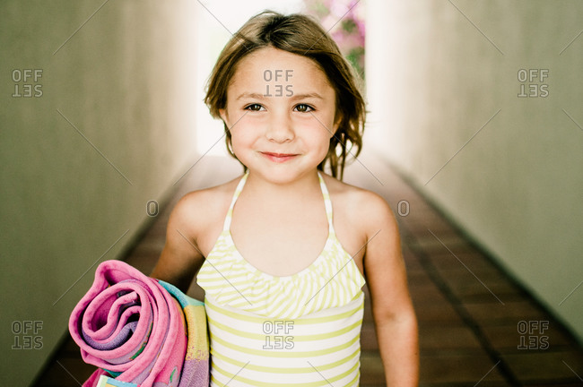 Portrait of girl carrying a beach towel