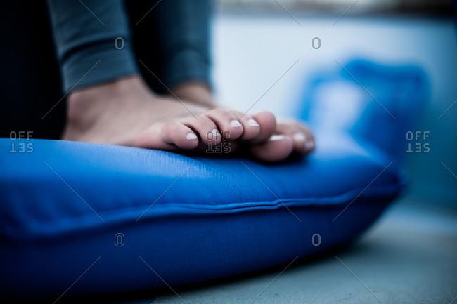 A woman's feet on a pillow
