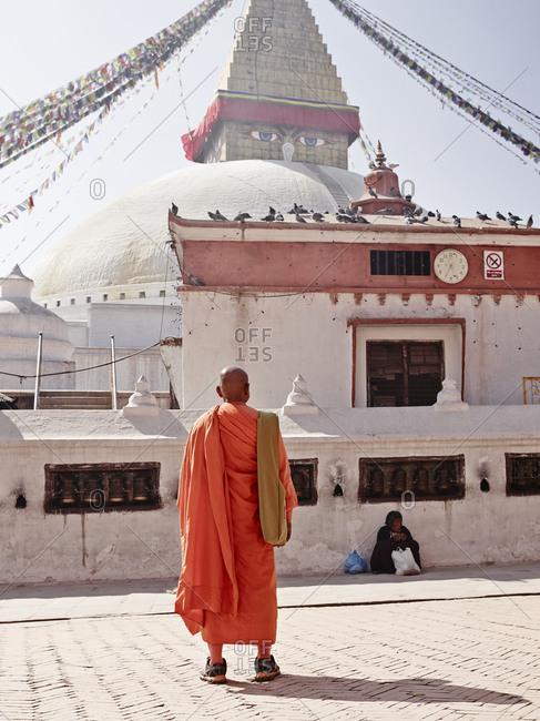 Katmandu, Nepal - February 9, 2013: A monk at the Boudhanath in Katmandu, Nepal