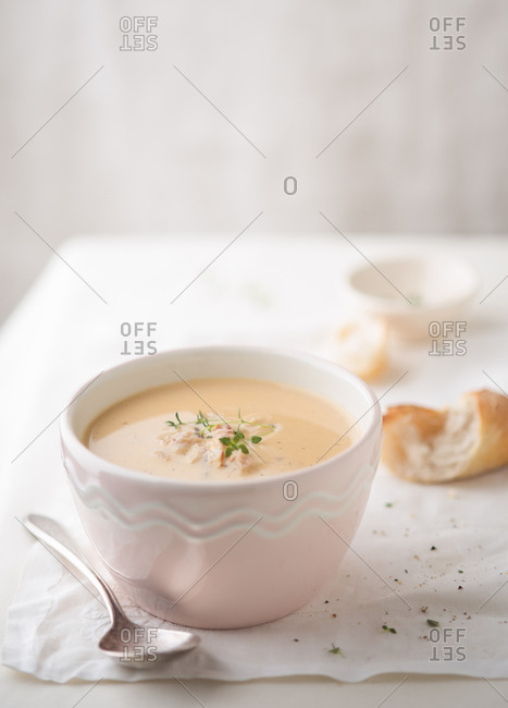 Bowl of crab bisque and garnish
