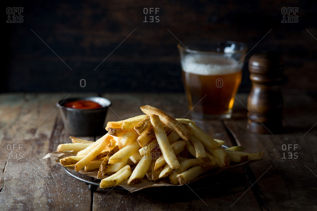 Plate of french fries with beer