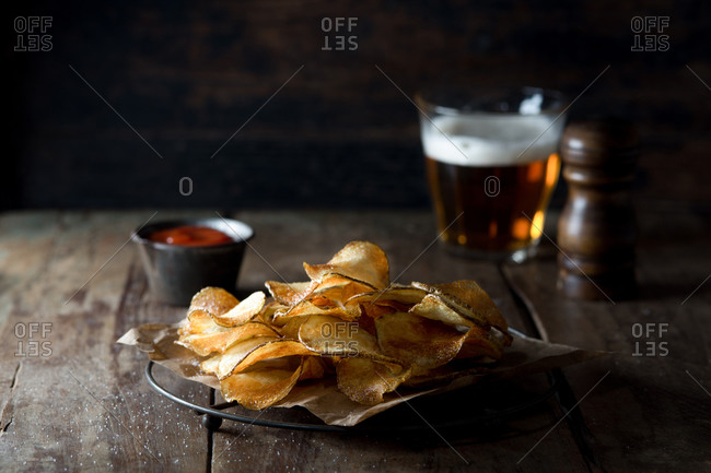 Plate of potato chips with beer