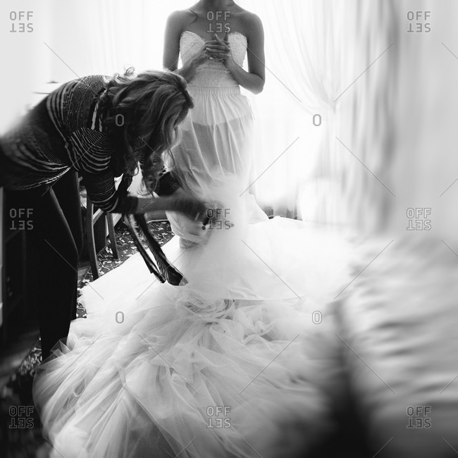 Bride with help getting into dress