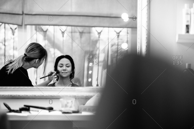 Bride getting blush applied
