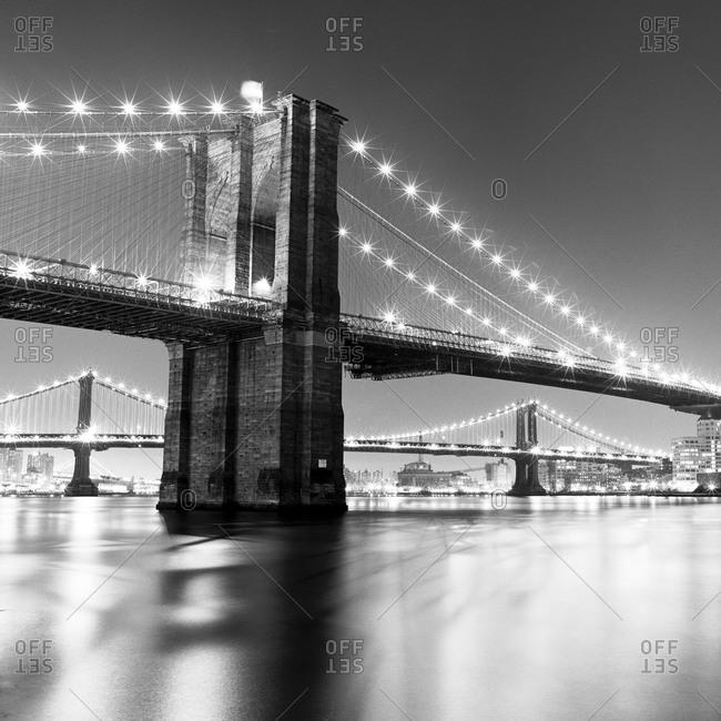 The Brooklyn Bridge and the Manhattan Bridge at night
