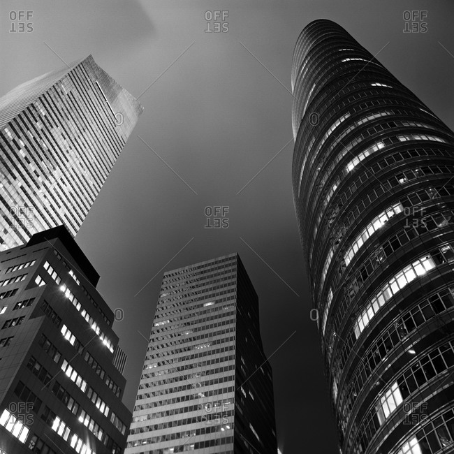 New York, NY, USA - January 11, 2015: High-rise buildings on a foggy night in Manhattan