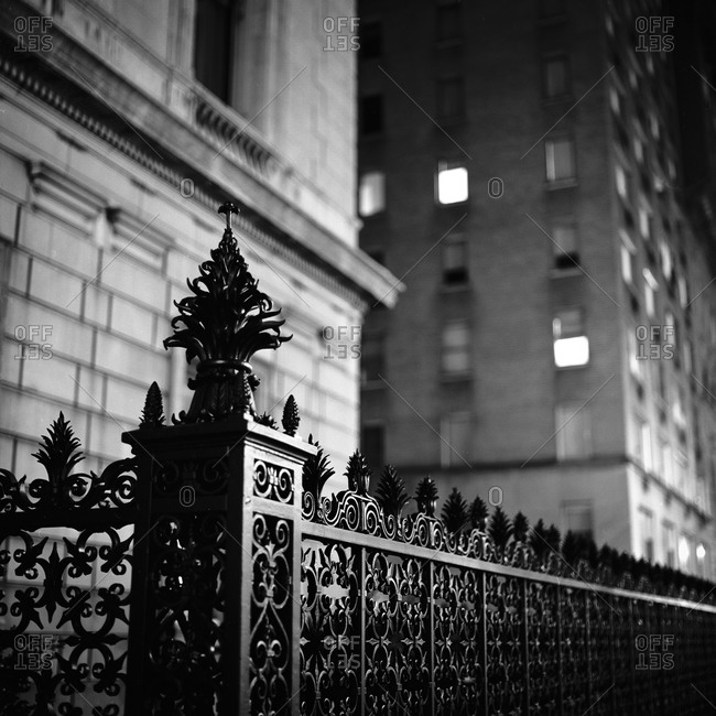 An ornate wrought iron fence on the street in Manhattan