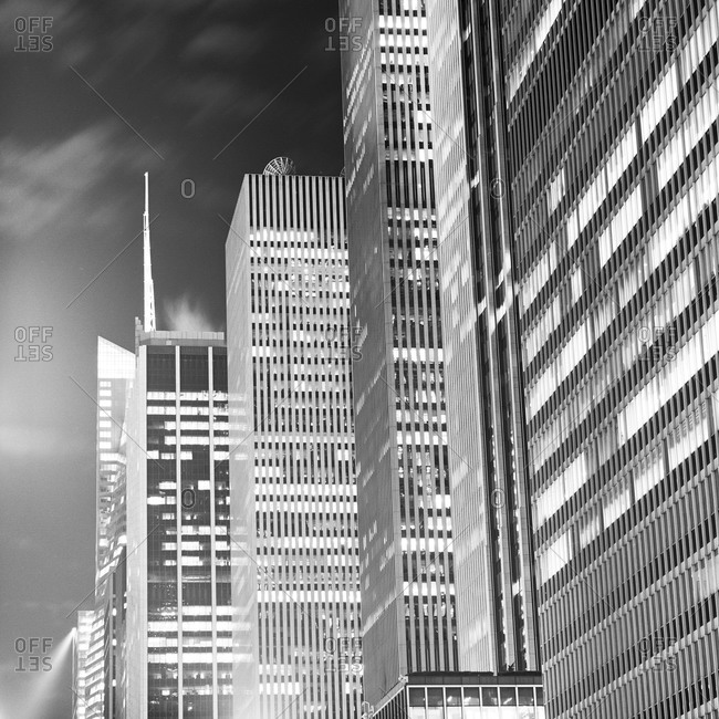 New York, NY, USA - May 11, 2011: Glass and steel buildings in Manhattan at night