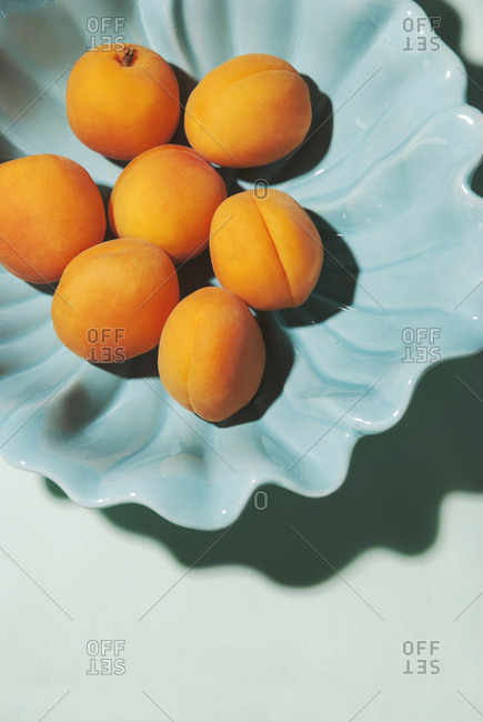 Apricots in wavy bowl