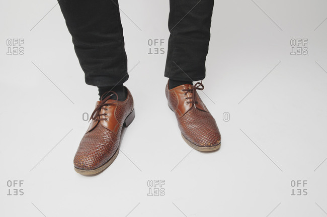 Feet of man with woven dress shoes
