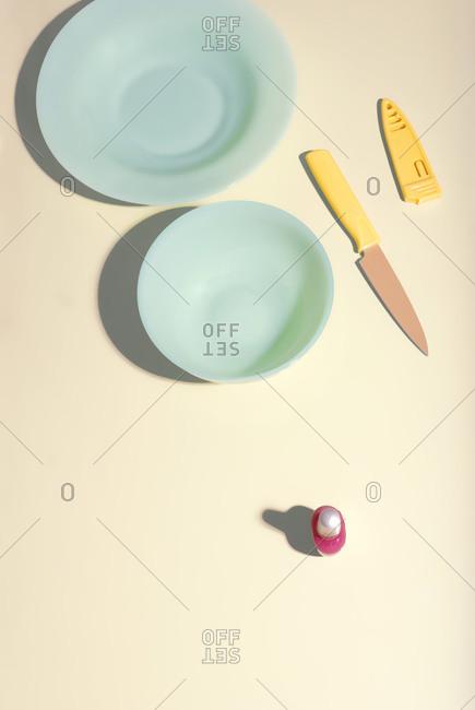 Dinnerware and chopping knife, studio shot