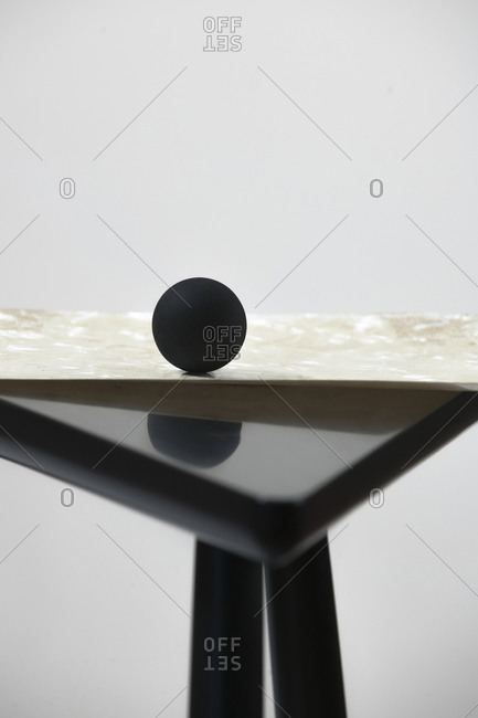Ball resting on table corner