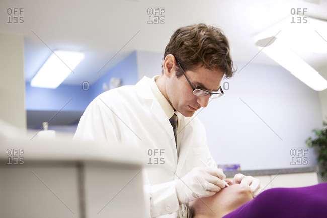Dentist checking the teeth of a patient