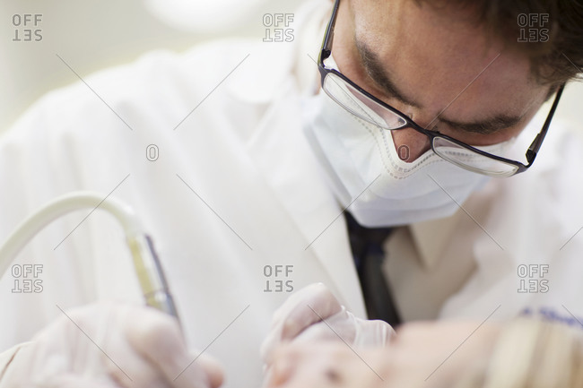 Close up of dentist performing procedure on patient
