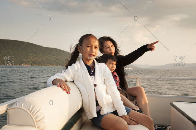 Mother with children traveling on a boat