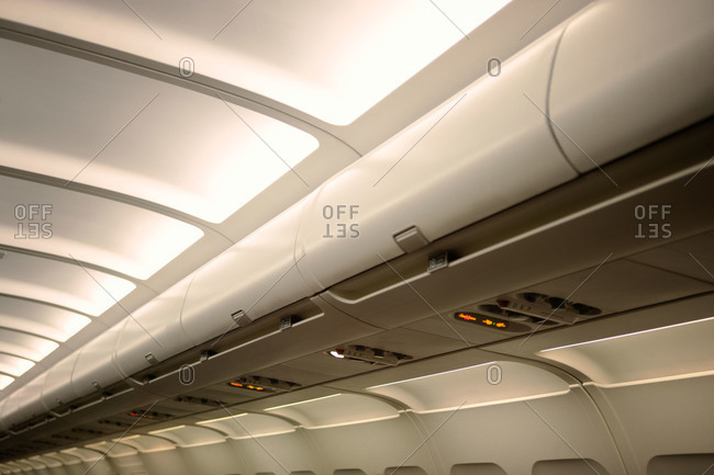 The overhead compartment of an airplane