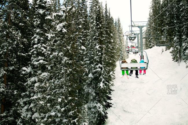 Skiers on a chairlift in Vail, Colorado