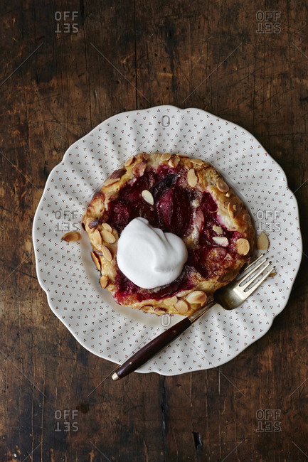 Plum tart served with cream