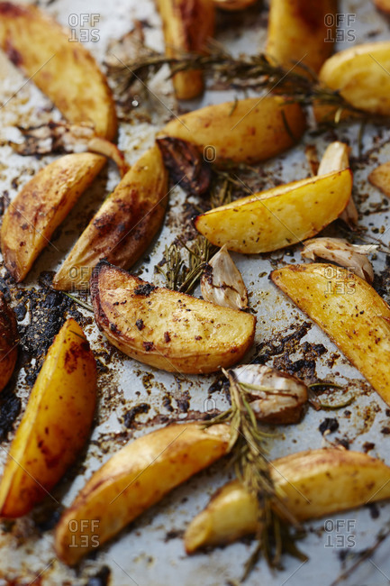 Pan roasted potato wedges with herbs