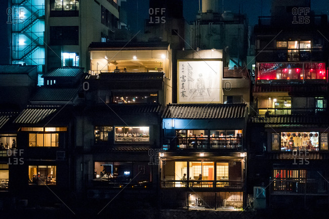 Kyoto, Japan - November 16, 2014: View into lighted windows of apartment buildings